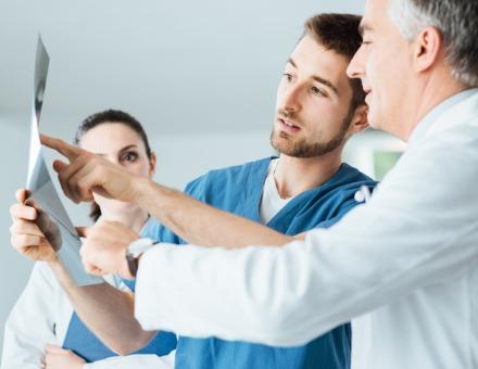 medical-team-examining-patients-xray